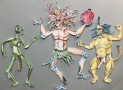 "Paper Dolls from Hell:Daemons of Xibalba, 2015, painted paper and brads, approximately 7-9"" tall"