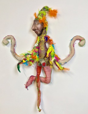 """Icarus"" 2017 Mixed media: acrylic painted recycled rag, embroidery floss, feathers, fiber-fill. 32 by 28 by 6 inches."