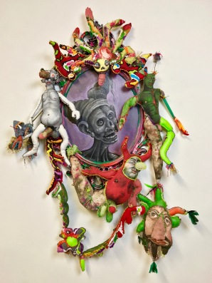 """Reflection of a Harsh Super Ego"" 2017 Mixed media: acrylic paint, recycled fabric, embroidery floss, feathers, IKEA mirror, fiber-fill. 50 by 32 by 6 inches"